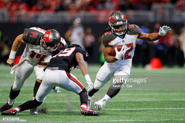 Jacquizz Rodgers of the Tampa Bay Buccaneers runs the ball during the second half against the Atlanta Falcons at MercedesBenz Stadium on November 26...