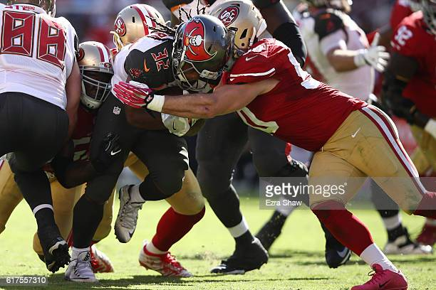 Jacquizz Rodgers of the Tampa Bay Buccaneers rushes with the ball against the San Francisco 49ers during their NFL game at Levi's Stadium on October...