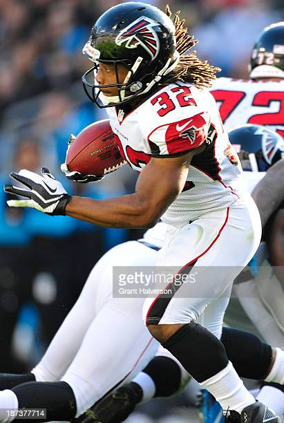 Jacquizz Rogers of the Atlanta Falcons against the Carolina Panthers during play at Bank of America Stadium on November 3 2013 in Charlotte North...