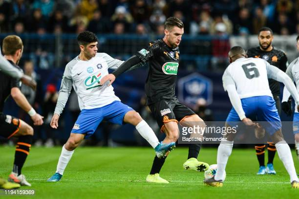 Jad MOUADDIB of Granville and Kevin STROOTMAN of Marseille during the French Cup Soccer match between US Granville and Olympique de Marseille at...