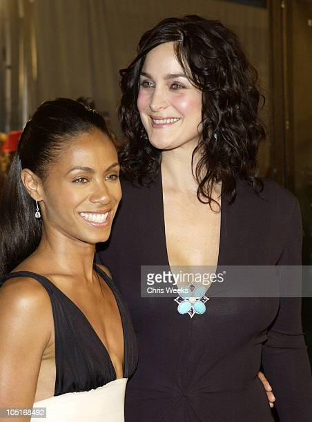 Jada Pinkett Smith and CarrieAnne Moss during 'Matrix Revolutions' Los Angeles Premiere Arrivals at Walt Disney Concert Hall in Los Angeles...