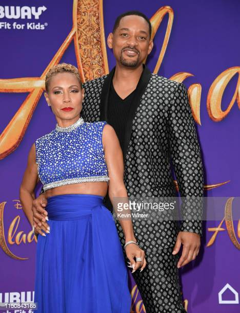 Jada Pinkett Smith and Will Smith attend the premiere of Disney's Aladdin at El Capitan Theatre on May 21 2019 in Los Angeles California
