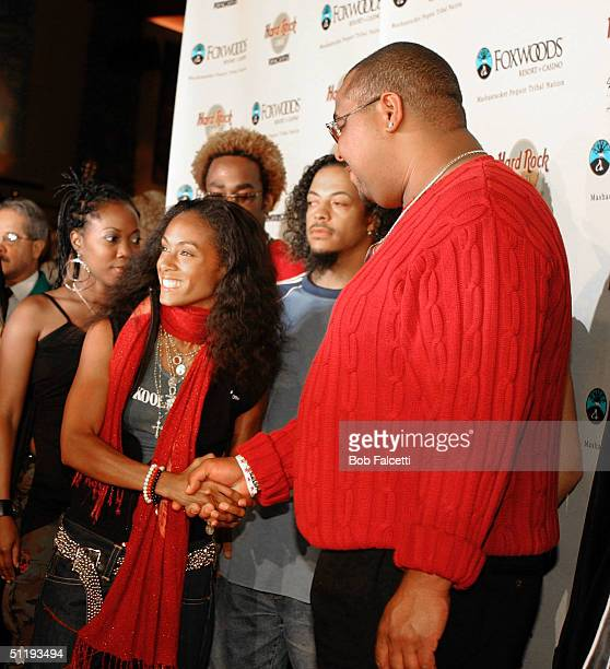 Jada Pinkett Smith shakes hands with Mashantucket Pequot Tribal Nation chairman Michael Thomas at the grand opening of the Hard Rock Cafe at the...