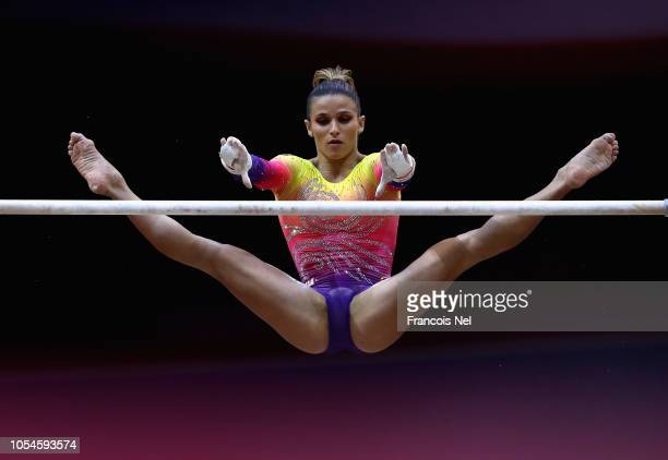 Jade Barbados of Brazil competes in the Women's Uneven Bar Qualification during day four of the 2018 FIG Artistic Gymnastics Championships at Aspire...