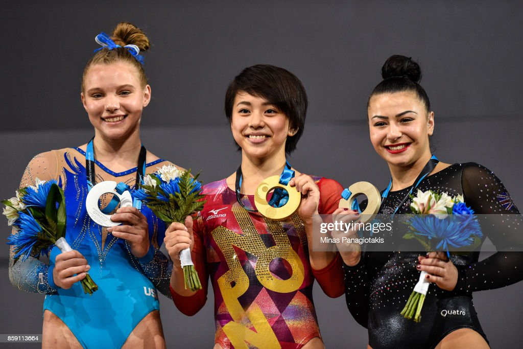 Jade Carey of The United States of America (L), Mai Murakami of Japan (C) and Claudia Fragapane of Great Britain (R) pose with their medals from the podium after competing on the floor exercise during the individual apparatus finals of the Artistic Gymnastics World Championships on October 8, 2017 at Olympic Stadium in Montreal, Canada.