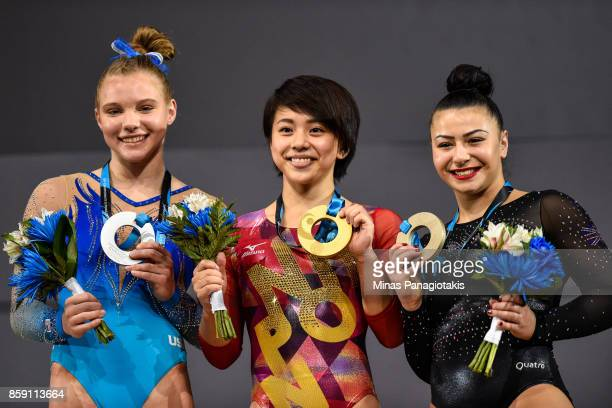 Jade Carey of The United States of America Mai Murakami of Japan and Claudia Fragapane of Great Britain pose with their medals from the podium after...