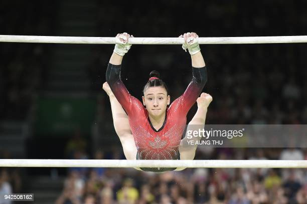 Jade Chrobok competes on the uneven bars during the women's team final and individual qualification in the artistic gymnastics event during the 2018...