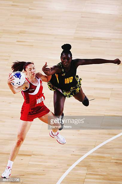 Jade Clarke of England and Vangelee Williams of Jamaica compete for the ball during the Netball Bronze Medal Match between England and Jamaica at...