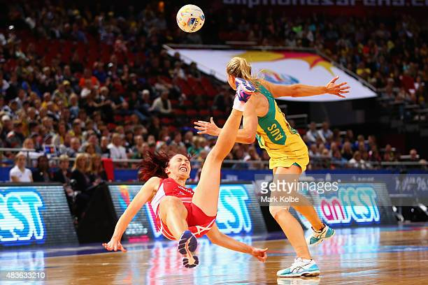 Jade Clarke of England falls after clashing with Laura Geitz Of Australia during the 2015 Netball World Cup Qualification round match between...