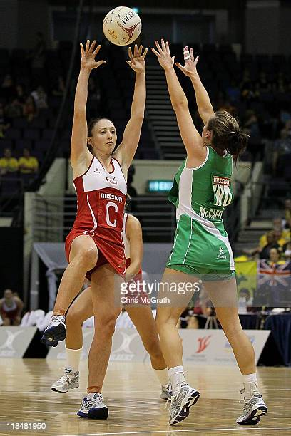 Jade Clarke of England throws a pass over Lisa McCaffrey of Northern Ireland during the match between Northern Ireland and England on day six of the...