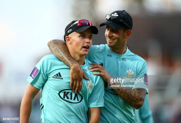 Jade Dernbach and Sam Curran of Surrey walk off the field during the NatWest T20 Blast match between Surrey and Gloucestershire at The Kia Oval on...