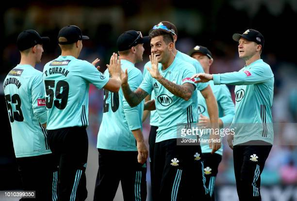 Jade Dernbach and Tom Curran of Surrey celebrate with their teammates after dismissing Nick Gubbins of Middlesex during the Vitality Blast match...