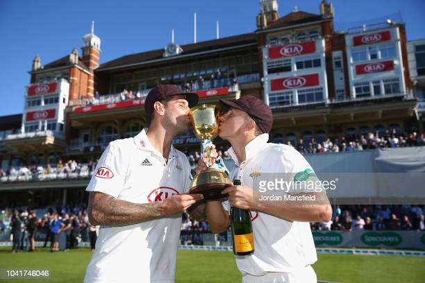Jade Dernbach and Tom Curran of Surrey celebrates with the Specsavers County Championship Division One Cup during Day Four of the Specsavers County...