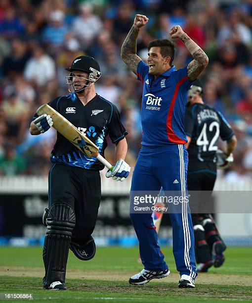 Jade Dernbach of England celebrates dismissing Colin Munro of New Zealand during the international Twenty20 match between New Zealand and England at...