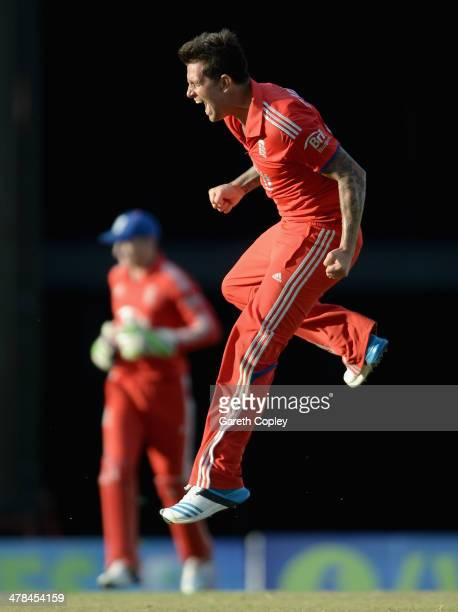 Jade Dernbach of England celebrates winning the 3rd T20 International match between the West Indies and England at Kensington Oval on March 13 2014...