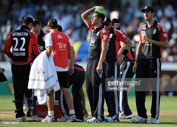 Jade Dernbach of England cools down during a drinks break during the 1st One Day International between England and India at The Rajiv Gandhi...