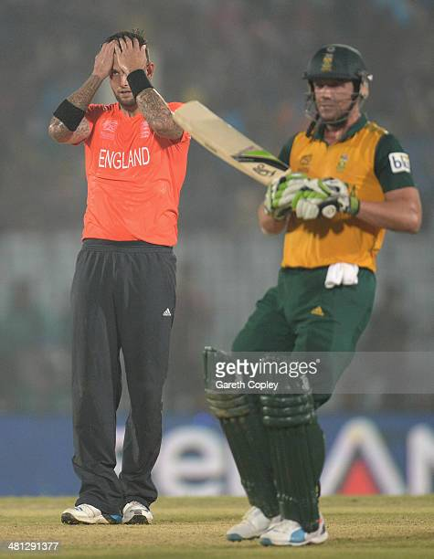 Jade Dernbach of England reacts after bowling to AB de Villiers of South Africa during the ICC World Twenty20 Bangladesh 2014 Group 1 match between...