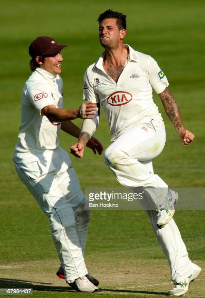 Jade Dernbach of Surrey celebrates after taking the wicket of Neil Dexter of Middlesex during the LV County Championship match between Middlesex and...