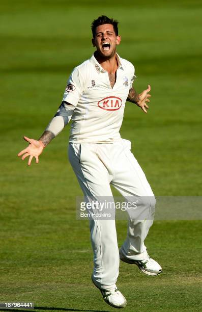 Jade Dernbach of Surrey celebrates after taking the wicket of Paul Stirling of Middlesex during the LV County Championship match between Middlesex...