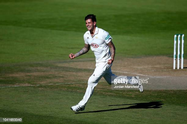 Jade Dernbach of Surrey celebrates dismissing Tom Westley of Essex during day three of the Specsavers County Championship Division One match between...