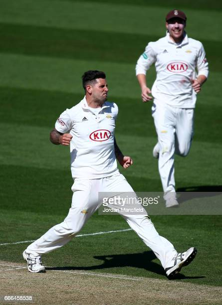 Jade Dernbach of Surrey celebrates getting the wicket of Sam Hain of Warwickshire during day three of the Specsavers County Championship Division One...