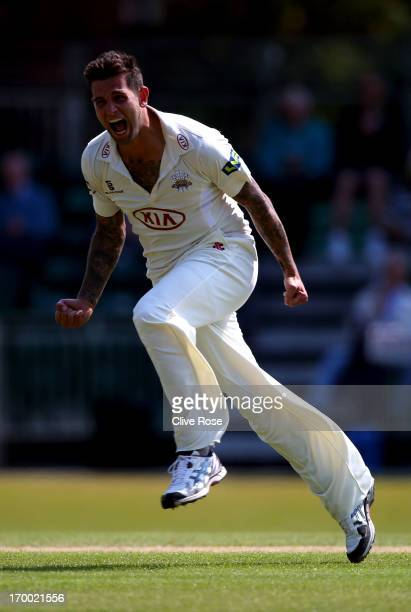 Jade Dernbach of Surrey celebrates taking the wicket of Varun Chopra of Warwickshire for 192 during day two of the LV County Championship Division...