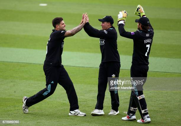 Jade Dernbach of Surrey celebrates with him teammates after dismissing Ravi Bopara of Essex during the Royal London OneDay Cup match between Surrey...