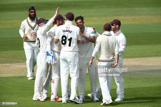 Jade Dernbach of Surrey celebrates with his teammates after dismissing Joe Weatherley of Hampshire during the Specsavers County Championship Division...