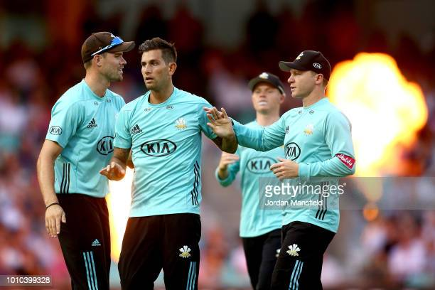 Jade Dernbach of Surrey celebrates with his teammates after dismissing Nick Gubbins of Middlesex during the Vitality Blast match between Surrey and...