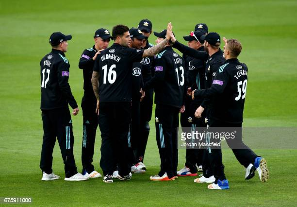 Jade Dernbach of Surrey celebrates with his teammates after dismissing Varun Chopra of Essex during the Royal London OneDay Cup match between Surrey...