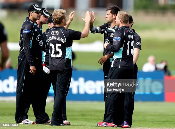 Jade Dernbach of Surrey celebrates with team make after taking the wicket of Sam Billings of Kent during the Friends Life T20 match between Kent and...