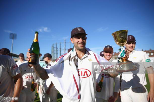 Jade Dernbach of Surrey celebrates with the Specsavers County Championship Division One Cup during Day Four of the Specsavers County Championship...
