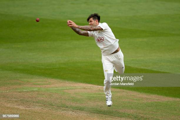 Jade Dernbach of Surrey dives for a catch during day three of the Specsavers County Championship Division One match between Surrey and Yorkshire at...
