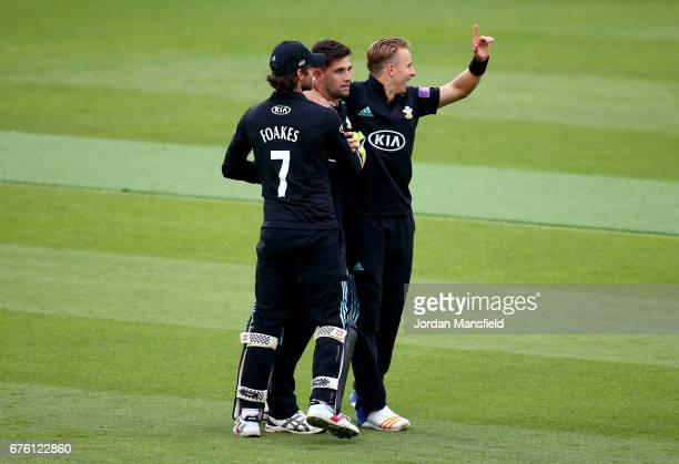 Jade Dernbach Tom Curran and Ben Foakes of Surrey celebrate dismissing Neil Wagner of Essex during the Royal London OneDay Cup match between Surrey...