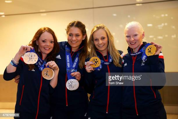Jade Etherington and her guide Caroline Powell of Great Britain guide Charlotte Evans and Kelly Gallacher of Great Britain show off their medals...