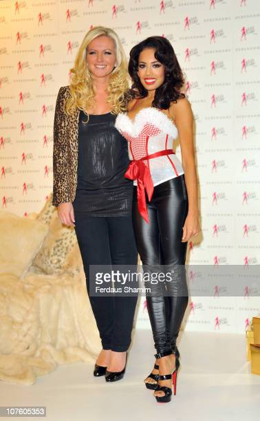 Jade Ewen and Michelle Mone appear in Miss Ultimo 'Santa Baby' basque at Debenhams on December 15 2010 in London England