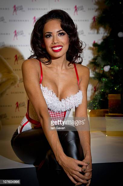 Jade Ewen attends a photocall for Ultimo wearing a Miss Ultimo Santa Baby basque at Debenhams Oxford Street on December 15 2010 in London England