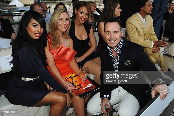 Jade Ewen Heidi Range and Amelle Berrabah of the Sugababes meet with David Furnish at the Amber Fashion Show and Auction held at the Meridien Beach...
