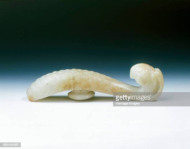 Jade garment hook Southern SongYuan dynasty China 11271368 A white jade garment hook the hook of which is formed by a ram's head in high relief with...