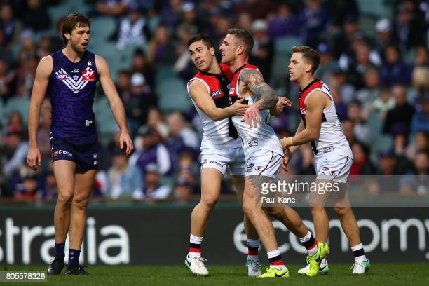 Jade Gresham and Tim Membrey of the Saints celebrate a goal as Joel Hamling of the Dockers looks on during the round 15 AFL match between the...