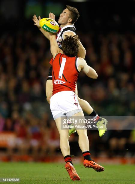 Jade Gresham of the Saints and Andrew McGrath of the Bombers compete for the ball during the 2017 AFL round 17 match between the St Kilda Saints and...