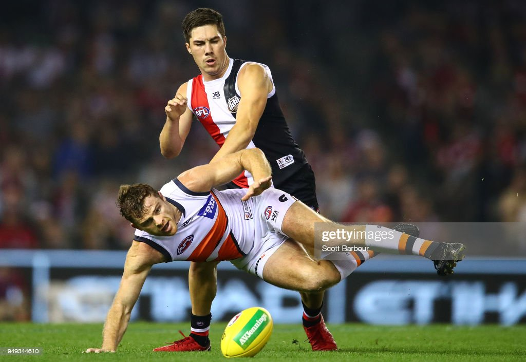 Jade Gresham of the Saints and Heath Shaw of the Giants compete for the ball during the round five AFL match between the St Kilda Saints and the Greater Western Sydney Giants at Etihad Stadium on April 21, 2018 in Melbourne, Australia.
