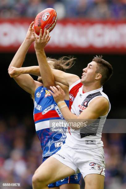 Jade Gresham of the Saints attempts to spoil Marcus Bontempelli of the Bulldogs during the round 10 AFL match between the Western Bulldogs and the St...