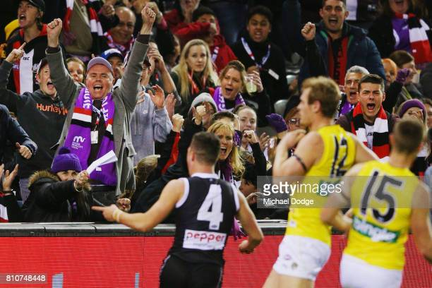 Jade Gresham of the Saints celebrates a goal with fans during the round 16 AFL match between the St Kilda Saints and the Richmond Tigers at Etihad...