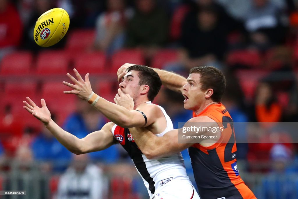 Jade Gresham of the Saints contests the ball with Heath Shaw of the Giants during the round 19 AFL match between the Greater Western Sydney Giants and the St Kilda Saints at Spotless Stadium on July 28, 2018 in Sydney, Australia.