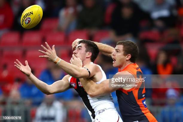 Jade Gresham of the Saints contests the ball with Heath Shaw of the Giants during the round 19 AFL match between the Greater Western Sydney Giants...
