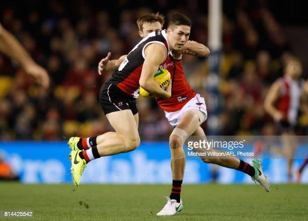 Jade Gresham of the Saints fends off Martin Gleeson of the Bombers during the 2017 AFL round 17 match between the St Kilda Saints and the Essendon...
