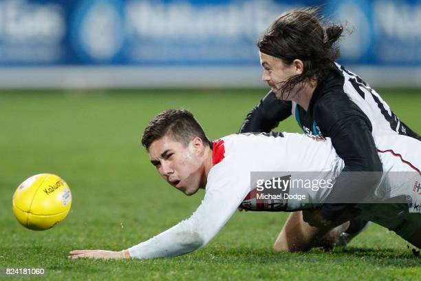 Jade Gresham of the Saints is tackled by Jasper Pittard of the Power during the round 19 AFL match between the Port Adelaide Power and the St Kilda...