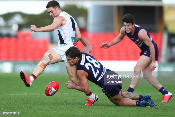 Jade Gresham of the Saints is tackled by Lachie Shultz of the Saints during the round 6 AFL match between the Fremantle Dockers and the St Kilda...