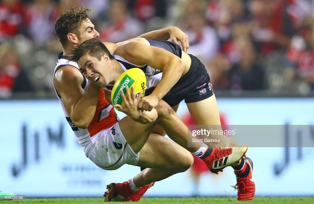 Jade Gresham of the Saints is tackled during the round five AFL match between the St Kilda Saints and the Greater Western Sydney Giants at Etihad Stadium on April 21, 2018 in Melbourne, Australia.